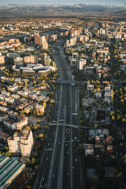 Madrid, Spain - November 10, 2017: Aerial shot of cityscape with modern buildings and huge high road