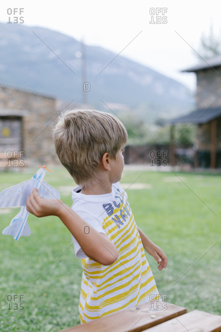Boy throwing paper plane