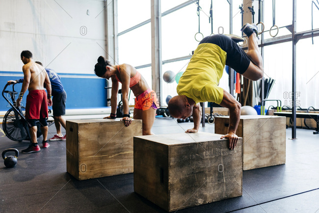 People training handstands on cubes
