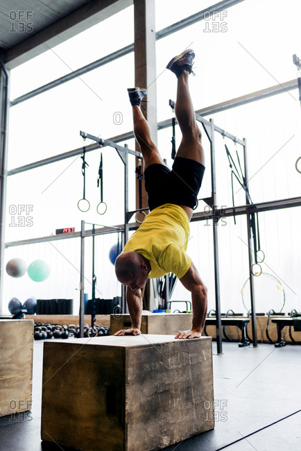 Man training handstands on cubes