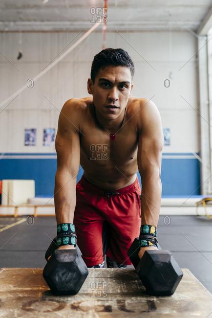 Muscular man lifting kettlebell