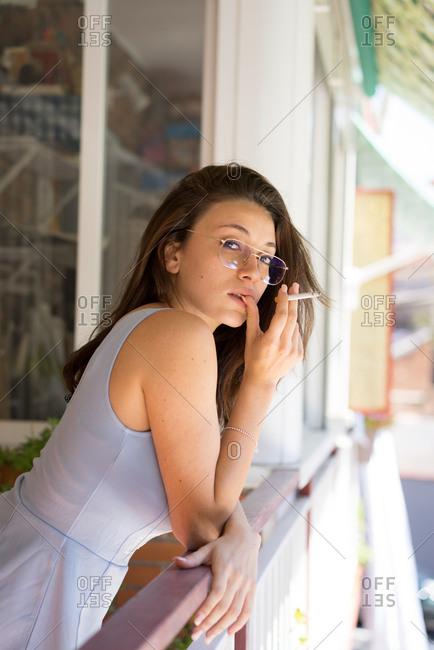 Woman smoking on balcony