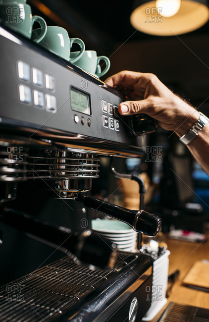 Man preparing coffee with espresso machine