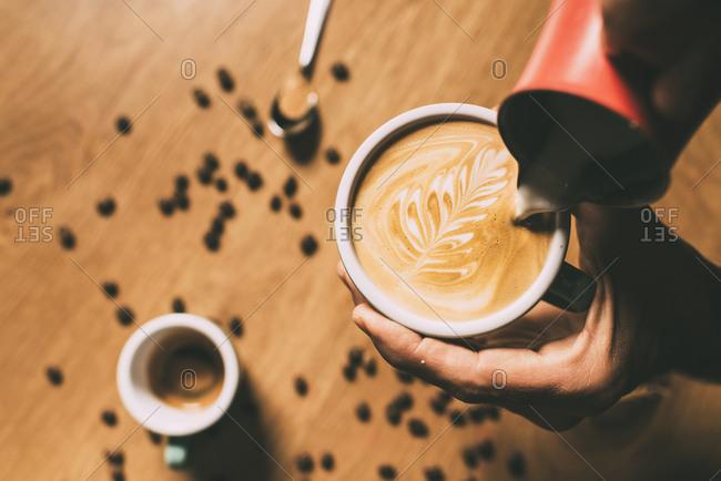 Person making latte art