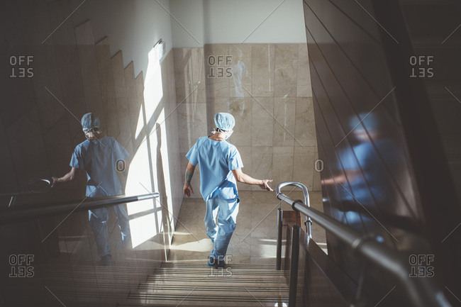 Man going down stairs in hospital
