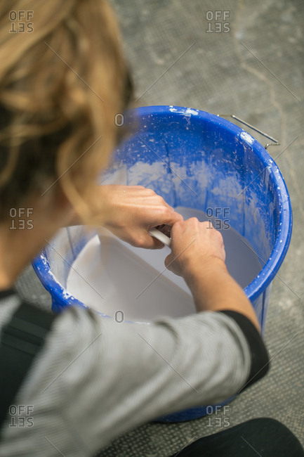 Anonymous person working with liquid clay