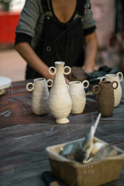 Artisan creating clay pots