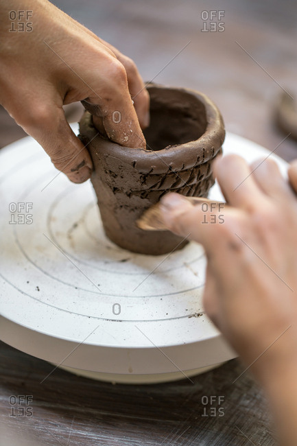 Close-up of person shaping clay