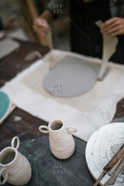 Artisan working in pottery studio