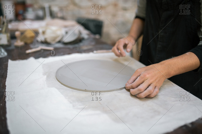 Artisan working in pottery studio