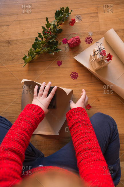 Boy wrapping some Christmas presents
