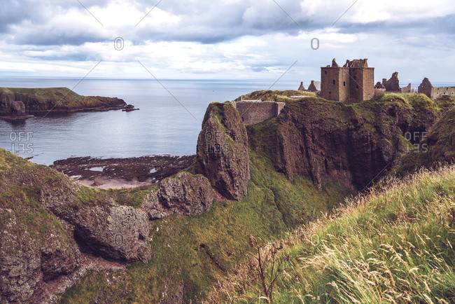 View of Dunnottar Castle standing on cliff on sea, Scotland