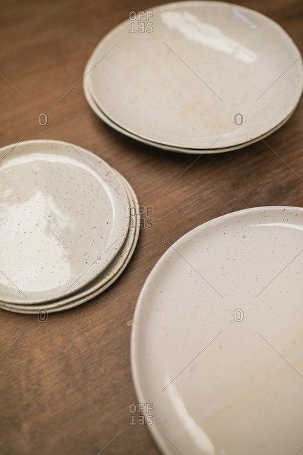 Rows of handicraft plates on table