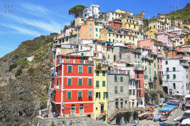 Liguria, Italy, Europe - July 27, 2017: The colorful sea village of Riomaggiore, Cinque Terre, UNESCO World Heritage Site