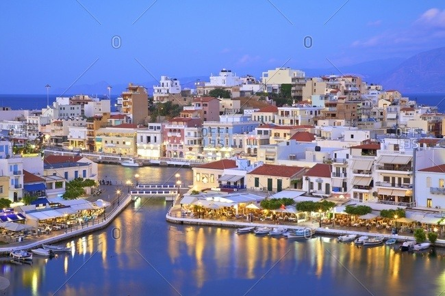 Agios Nikolaos, Crete, Greek Islands, Greece, Europe - May 22, 2017: Agios Nikolaos Harbour from an elevated angle at dusk, Agios Nikolaos, Crete, Greek Islands, Greece, Europe