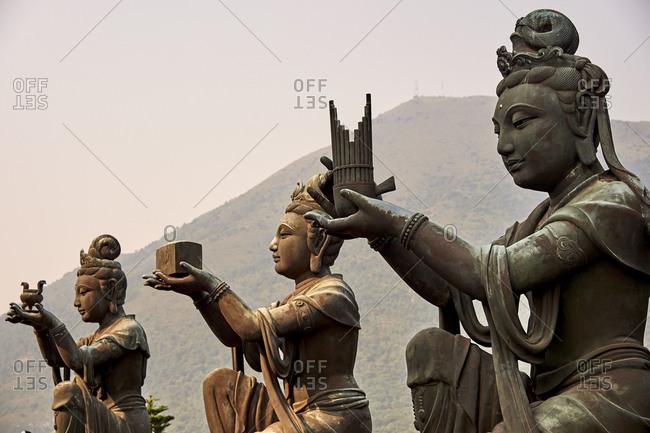 Supporting figures, Po Lin Monastery, Ngong Ping, Lantau Island, Hong Kong, China, Asia