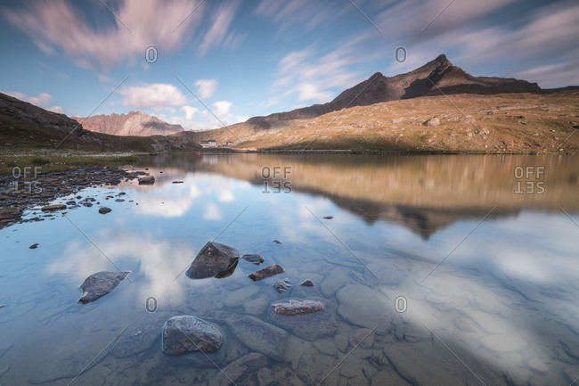 Clouds reflected in water at dawn, Lago Bianco, Gavia Pass, Valfurva, Valtellina, Lombardy, Italy, Europe