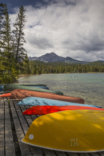 colorful canoes and kayaks on the bank of Annette Lake with Pyramid Mountain in the background, Jasper National Park, UNESCO World Heritage Site, Canadian Rockies, Alberta, Canada, North America
