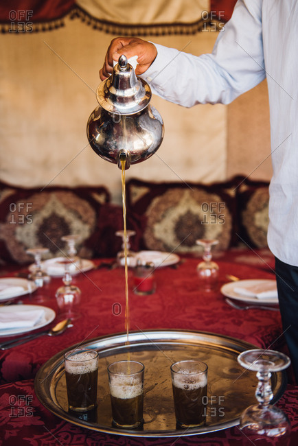 Waiter pouring tea in a Moroccan restaurant