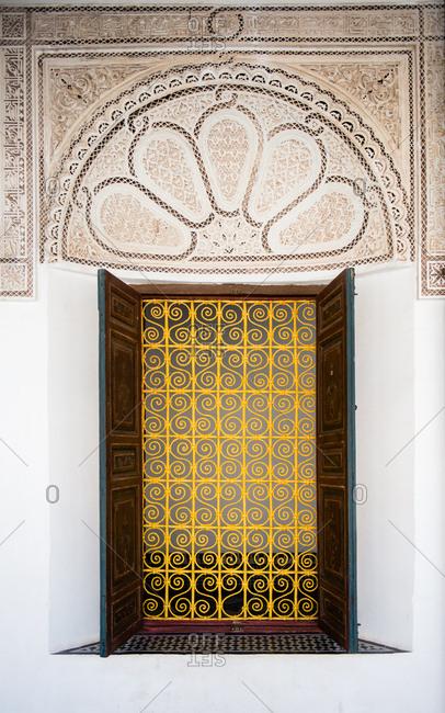 Window with yellow scroll screen on the Bahia Palace