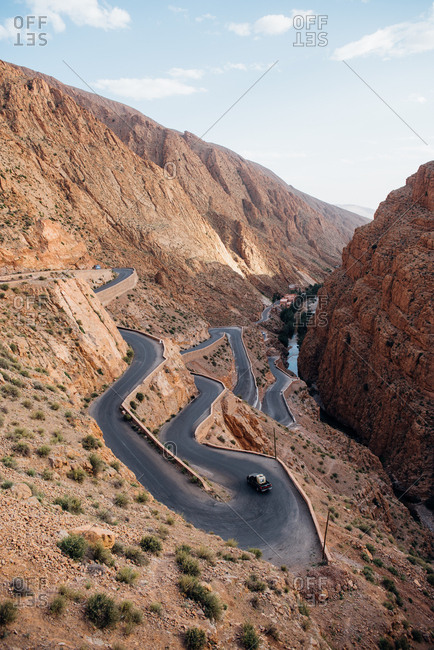 Dades Valley, Morocco - May 7, 2017: Cars driving on winding road on mountainside in Dades Valley