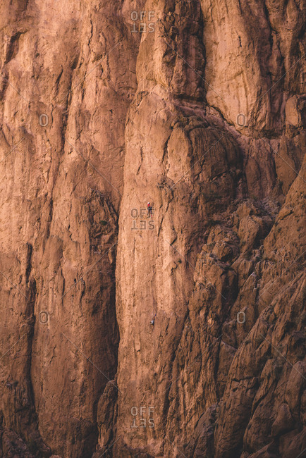 Rock climber at Tondra Gorge, Morocco