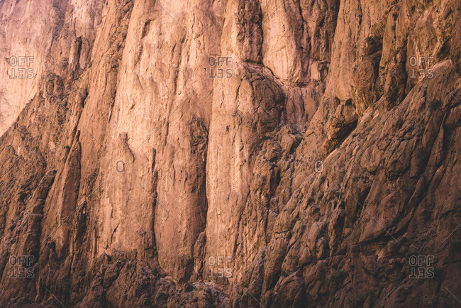 A rock climber at scaling walls of Tondra Gorge, Morocco