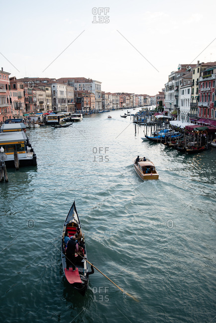 Venice, Italy - May 10, 2017: View of boats in the canal from Rialto bridge