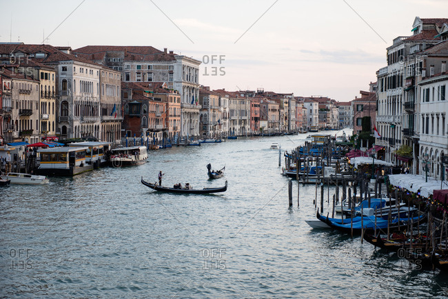 Venice, Italy - May 10, 2017: View of gondolas in the canal from Rialto bridge