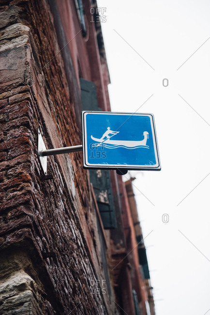 Boat sign on brick building in Venice, Italy