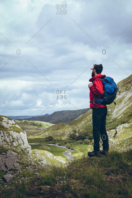 Male hiker looking at the view on countryside landscape