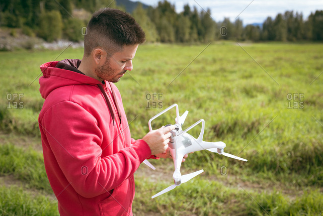 Man adjusting camera on drone before take off
