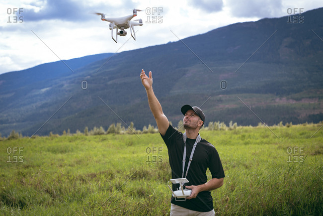 Man with a remote control simply throw the drone in the air