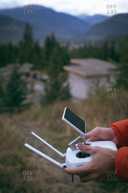 Close-up of man holding a remote control