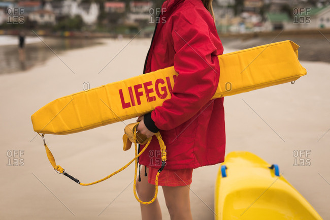 e0fdfc6a5979 ... Close-up of female lifeguard holding float in her arm
