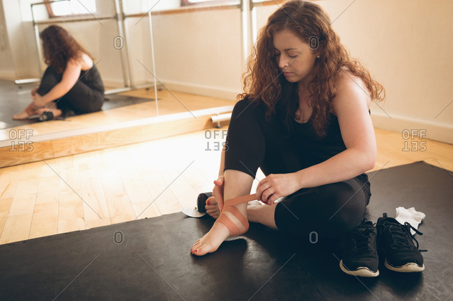 Irish dancer wearing dance socks in the studio