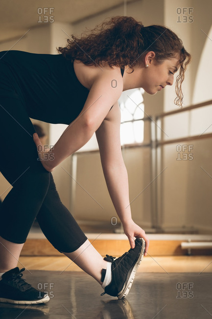 Irish dancer exercising before dance in the studio