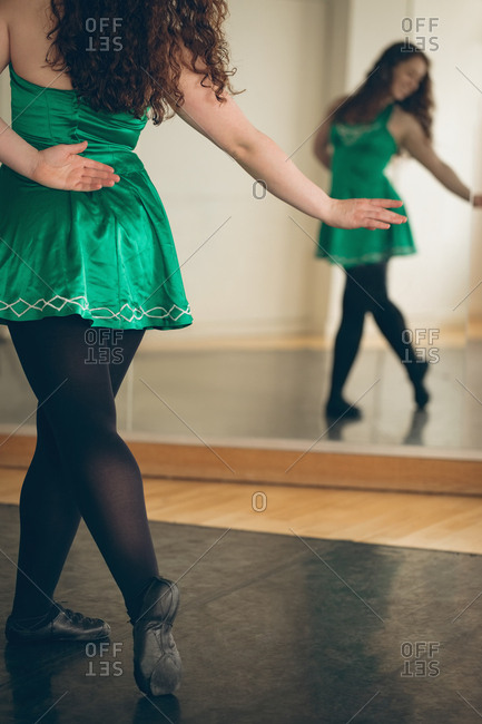 Irish dancer performing in front of the mirror in the studio