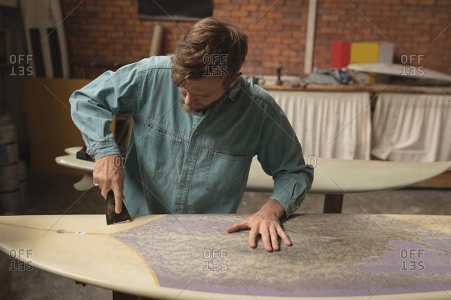 Employee in a surfboard workshop