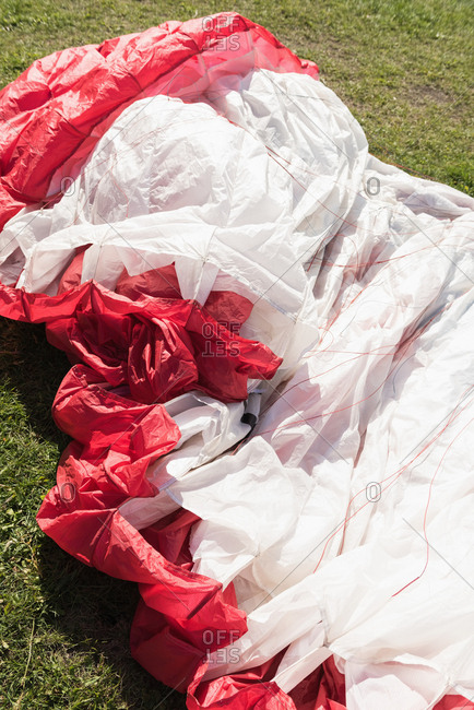 Parachute lying on landscape on a sunny day