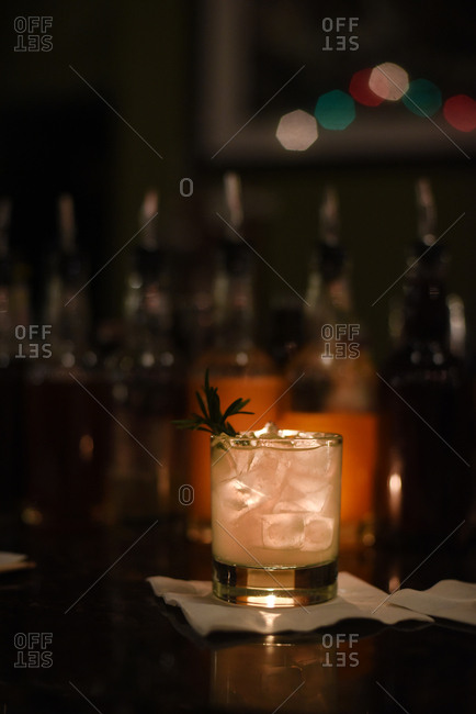 Chilled cocktail served on a bar with backlighting