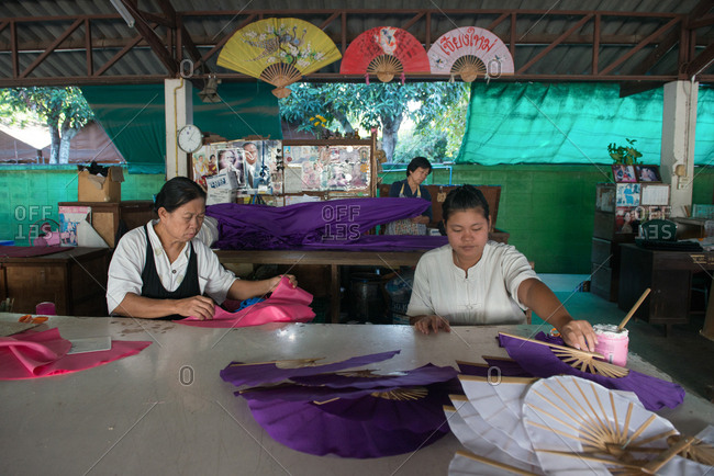 Chiang Mai, Thailand - November 24, 2017: Thai women making folding fans