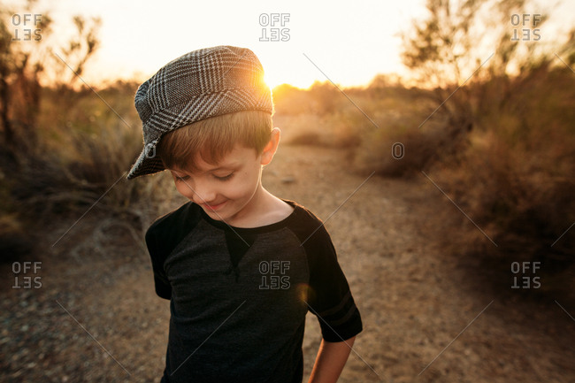 Portrait of a little boy in the desert at sunset