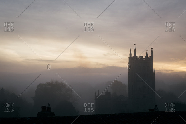 Historic church on a foggy day in Bruton, England