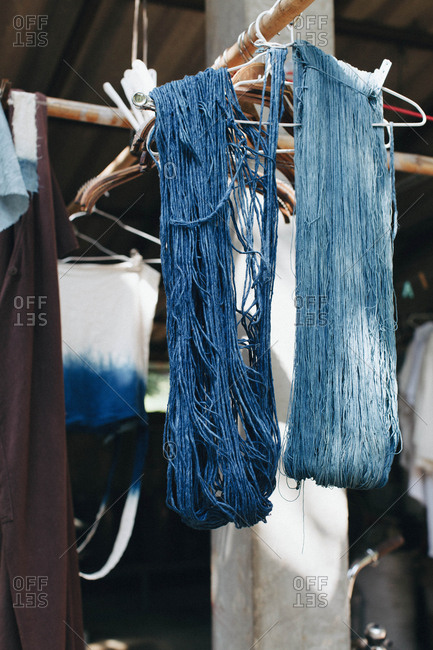 Indigo blue dyed string hanging up to dry at the artist's studio in northern Thailand