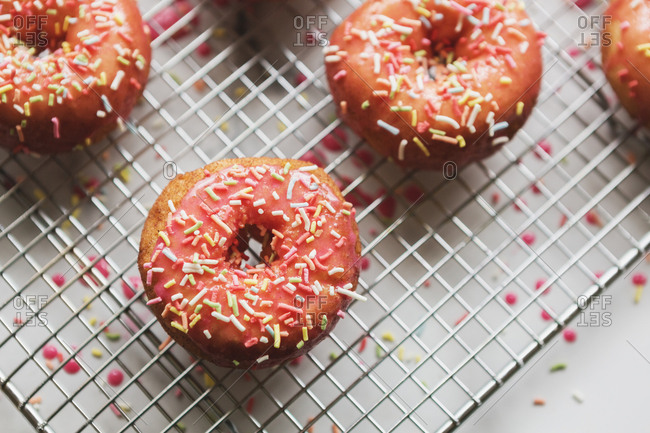 Overhead view of a rack of decorated pink donuts