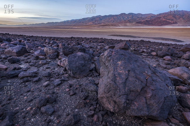 Volcanic rock formations in the foreground with Death Valley in the background