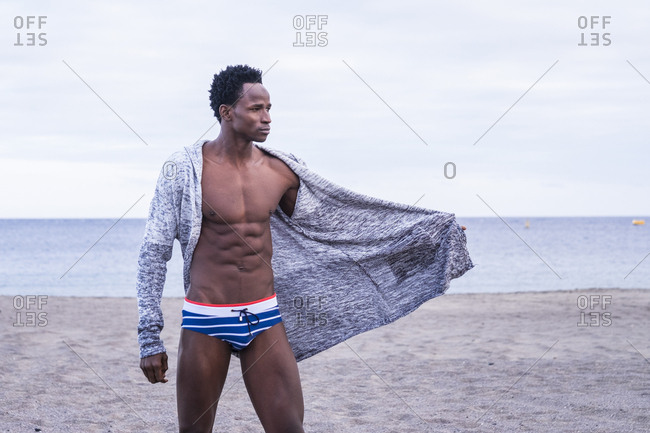 Athletic black man wearing men\'s swim briefs