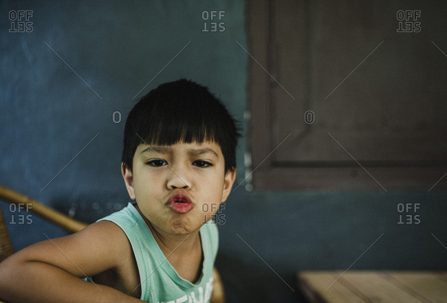Little boy making silly facial expression