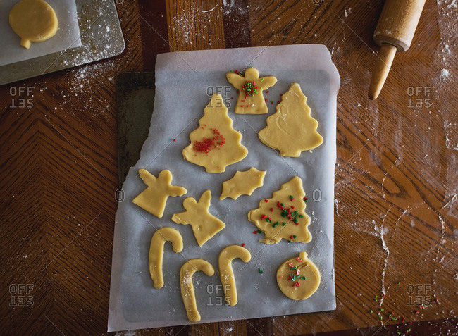 Overhead view of raw Christmas cut-out sugar cookies